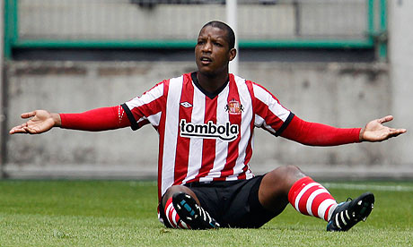 soccer player titus bramble sitting on the ground