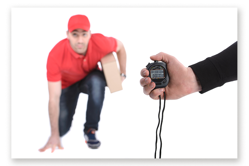 hand holding a stop watch with man in the background about to run